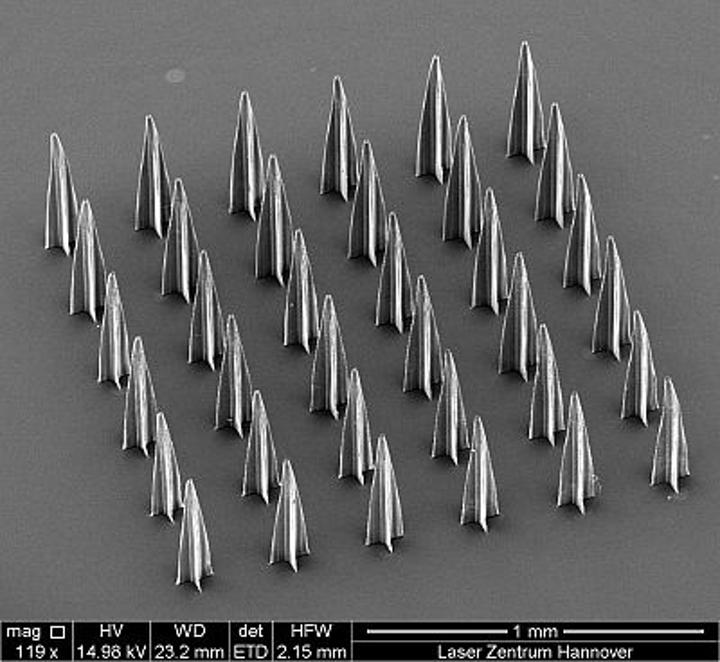 Microneedles created using multi-foci two-photon polymerization, which show promise for pain-free glucose sensing and insulin delivery.