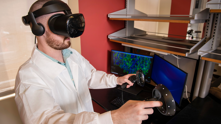 Biological Sciences graduate student Brendan Gallagher views expansion microscopy data using virtual reality.