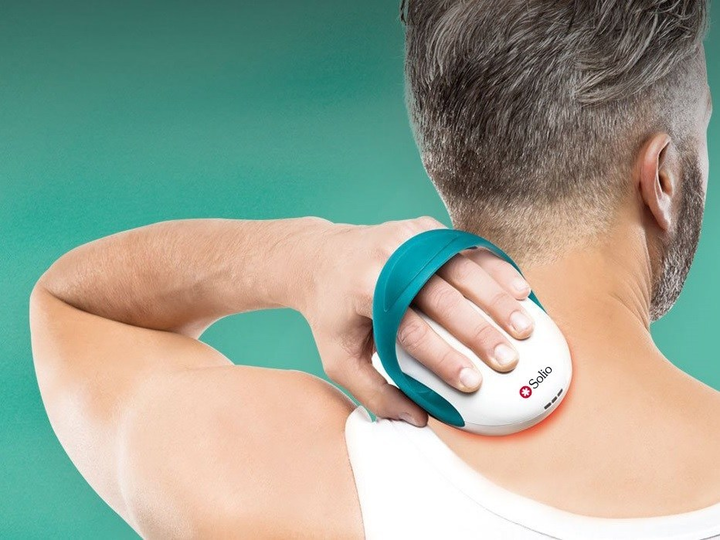 The Alfa Plus combination therapy device for pain relief treatment is shown in use.