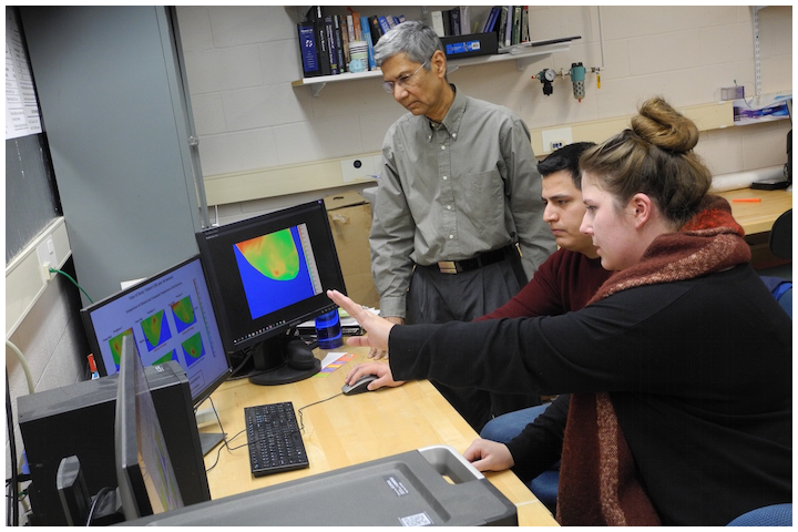 RIT and Rochester Regional Health researchers developed an infrared imaging technology to support current breast cancer detection methods. Professor Satish Kandlikar (left to right) and doctoral students Jose Luis Gonzalez Hernandez and Alyssa Recinella discuss an artificial intelligence system that can provide predictive analytics to determine more information about progression of disease.